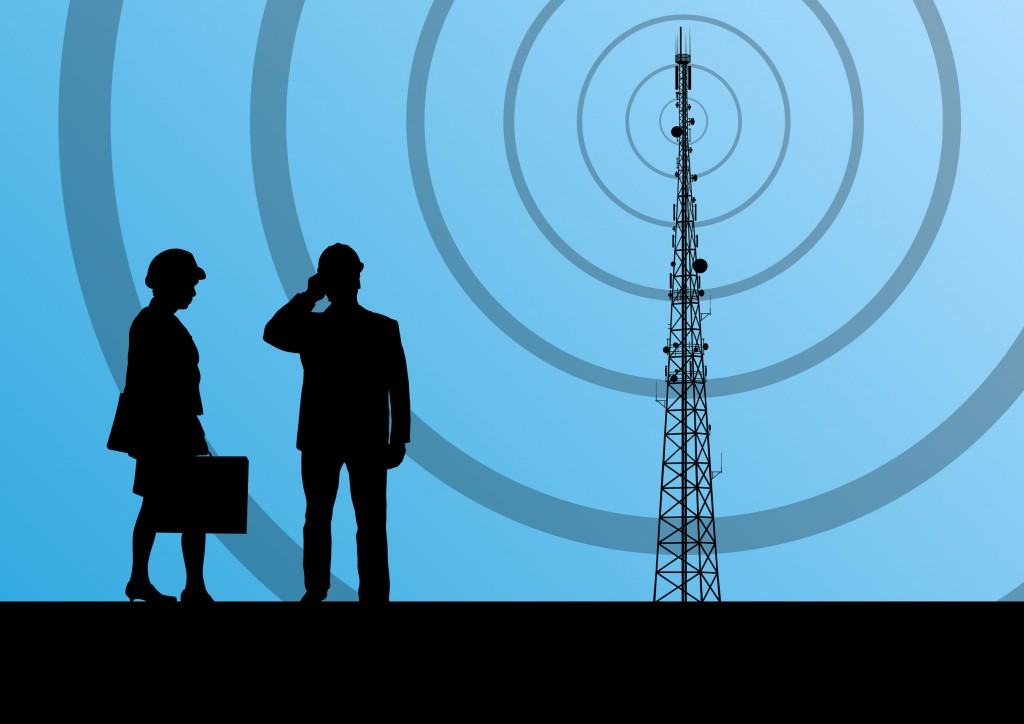 22893884 - telecommunications radio tower or mobile phone base station with engineers in concept background